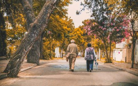 Older couple walking during fall
